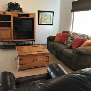 Living room includes television with DVD and cable TV subscription