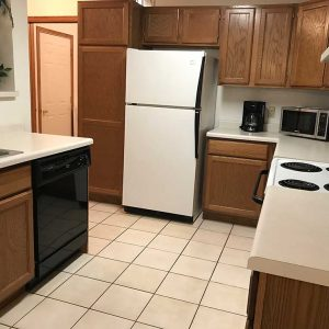 Kitchen is fully equipped with a conventional cooking stove with oven, full size refrigerator, microwave oven, toaster, coffee pot, a complete set of cooking utensils, and dinnerware and glassware for six