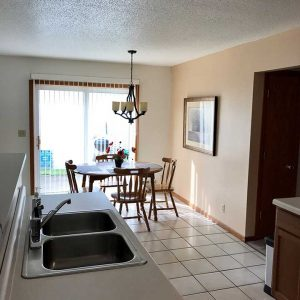 Besides the fully-furnished dining room, your SuiteHome features a walk-out patio for relaxing or cooking-out