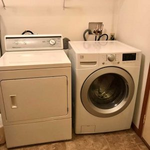 Full sized laundry with washer and dryer